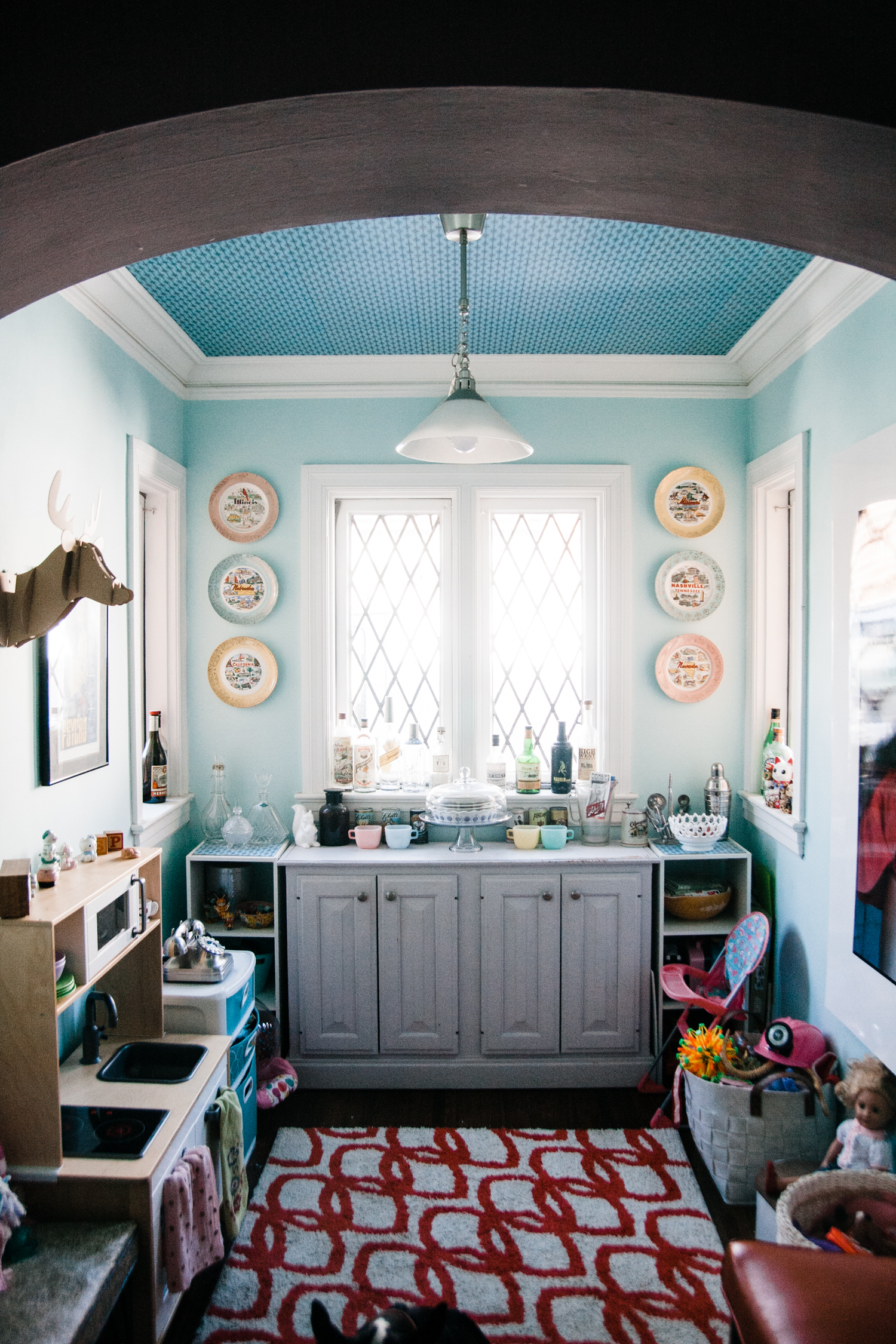 Claudette's sun-filled playroom. Check out the ceiling! Allison meticulously hand cut and pasted this vintage-style scrapbook paper.