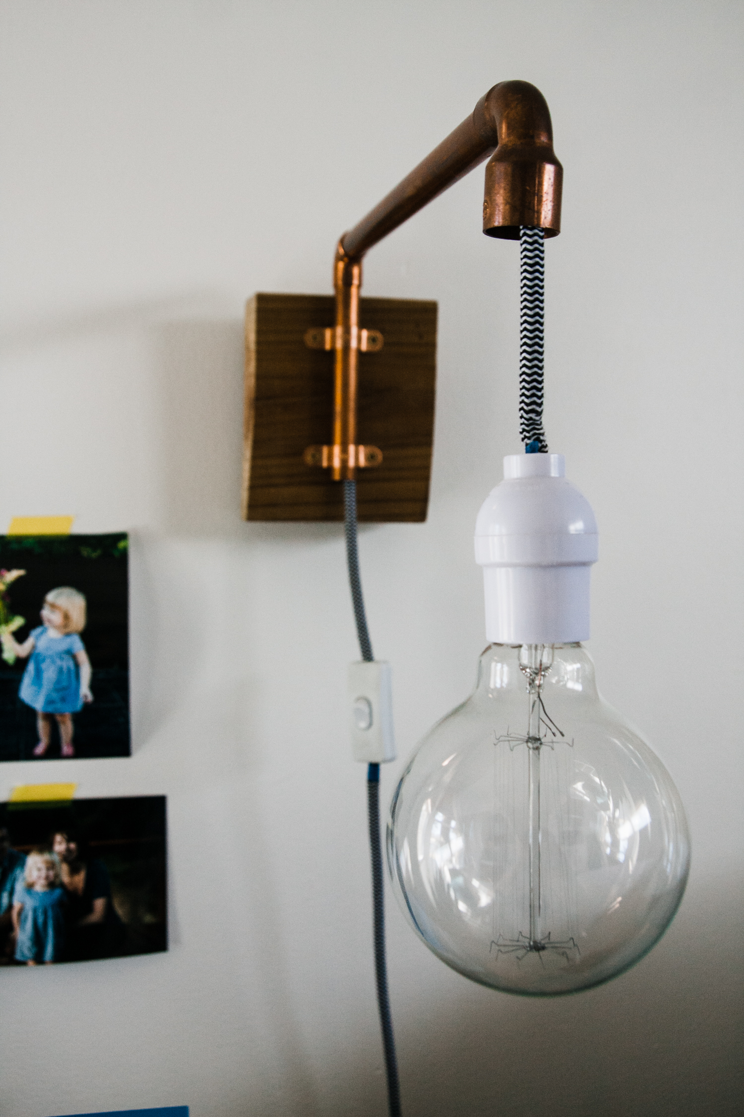 My husband made this wall-mounted lamp.