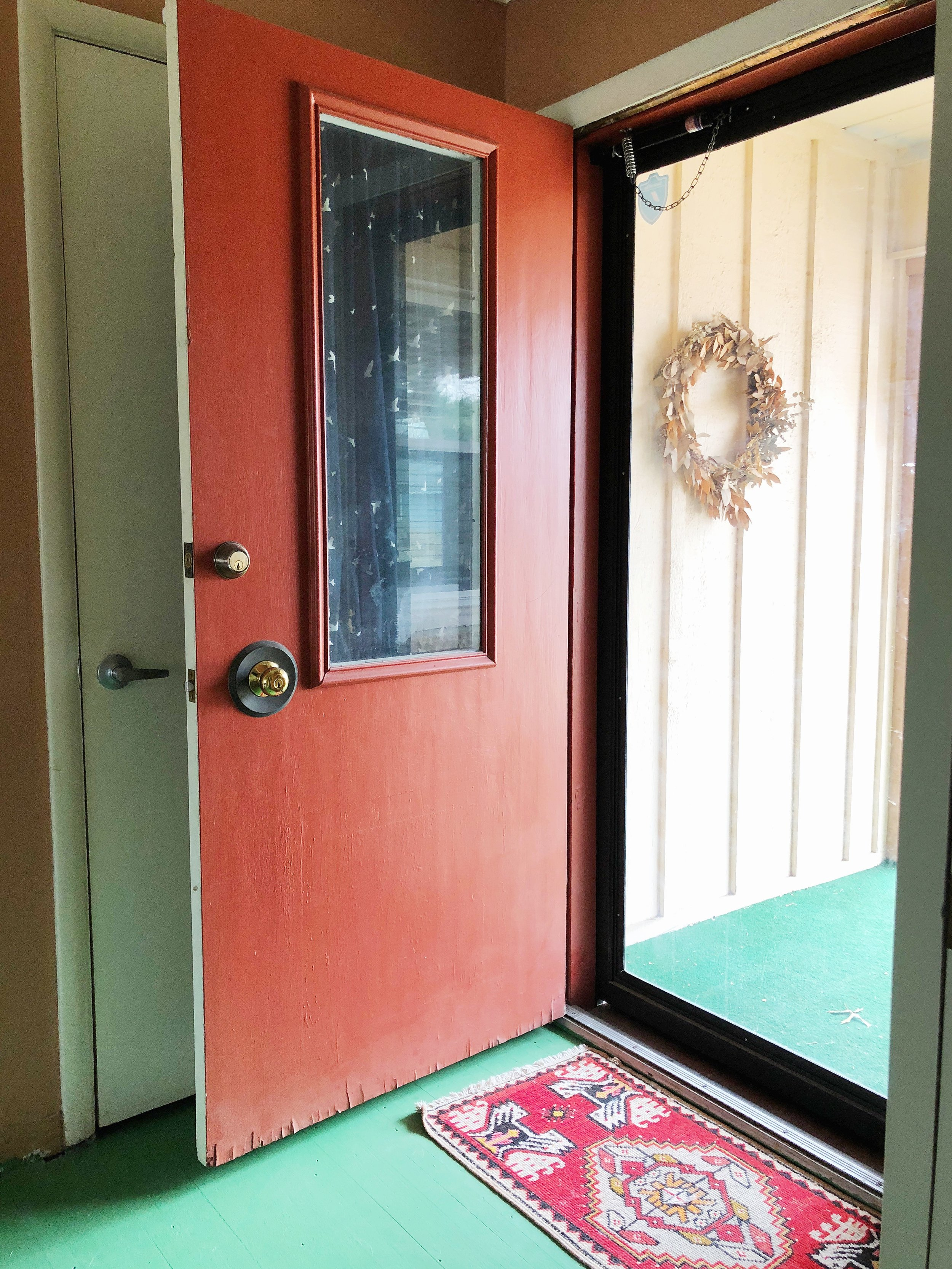 Clearly, we are drawn to red in our homes too. We both have red(ish) doors. Weird!