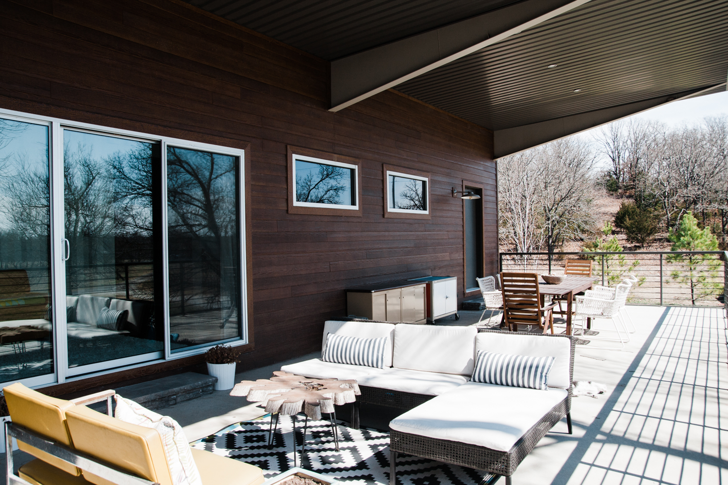 The family loves using the second story covered deck– even (or especially) on rainy days.