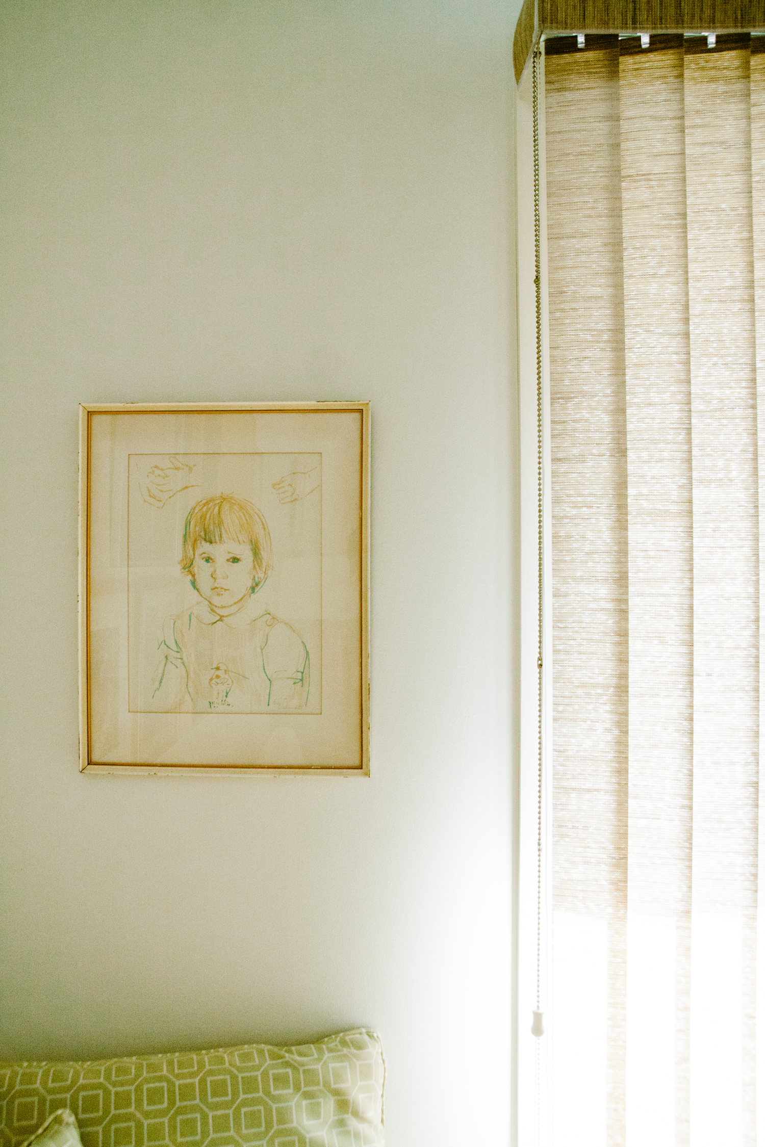 This is a portrait of baby Annie. We love how it is now nestled in this corner and Annie can see it from her desk.