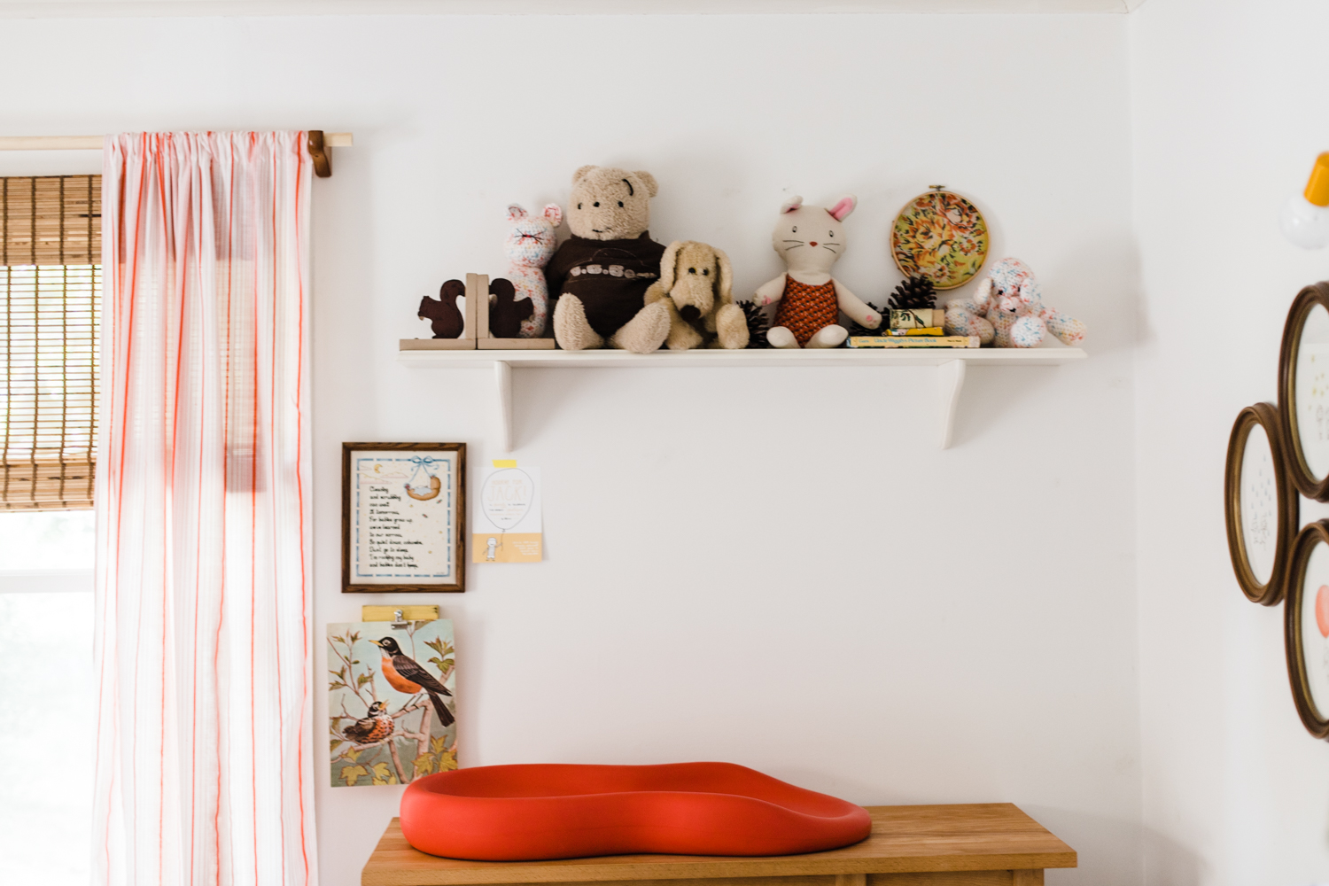 I switched up the decor above the changing table a bit. I wanted a place to sit special stuffed animals that were a little more fragile.These are toys I enjoy seeing every day, and they are a little more protected than the animals stuffed in a vintage toy chest (note that Caroline is still allowed to play with these animals; I'm not a monster).