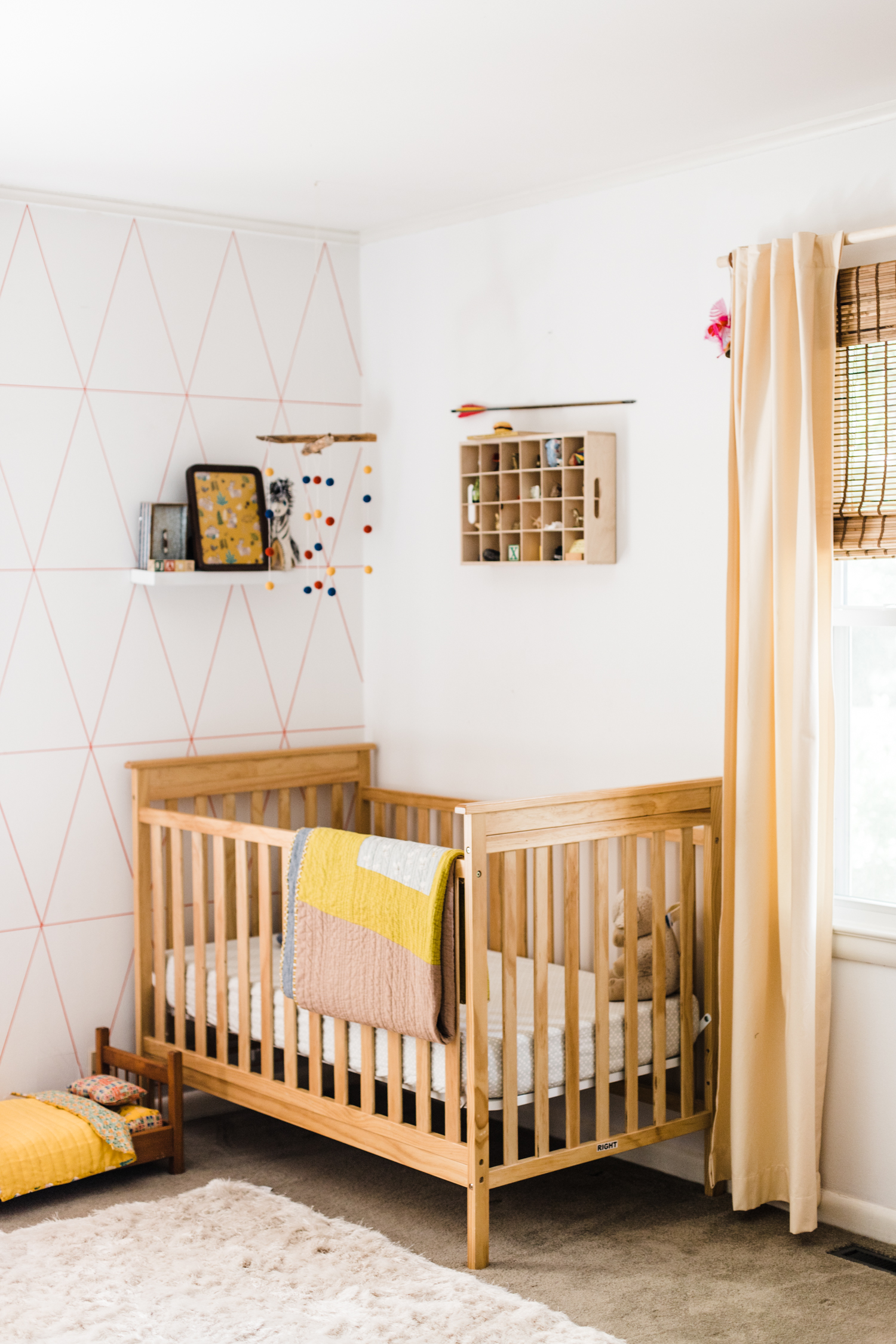 Jack's side of the room! We reused Caroline's crib since she is now a big girl. Jack won't sleep in here for a while, but it's nice to have it ready for when he's old enough to move in. For anyone with a shared kid room–at what age did you move your baby into the shared room?