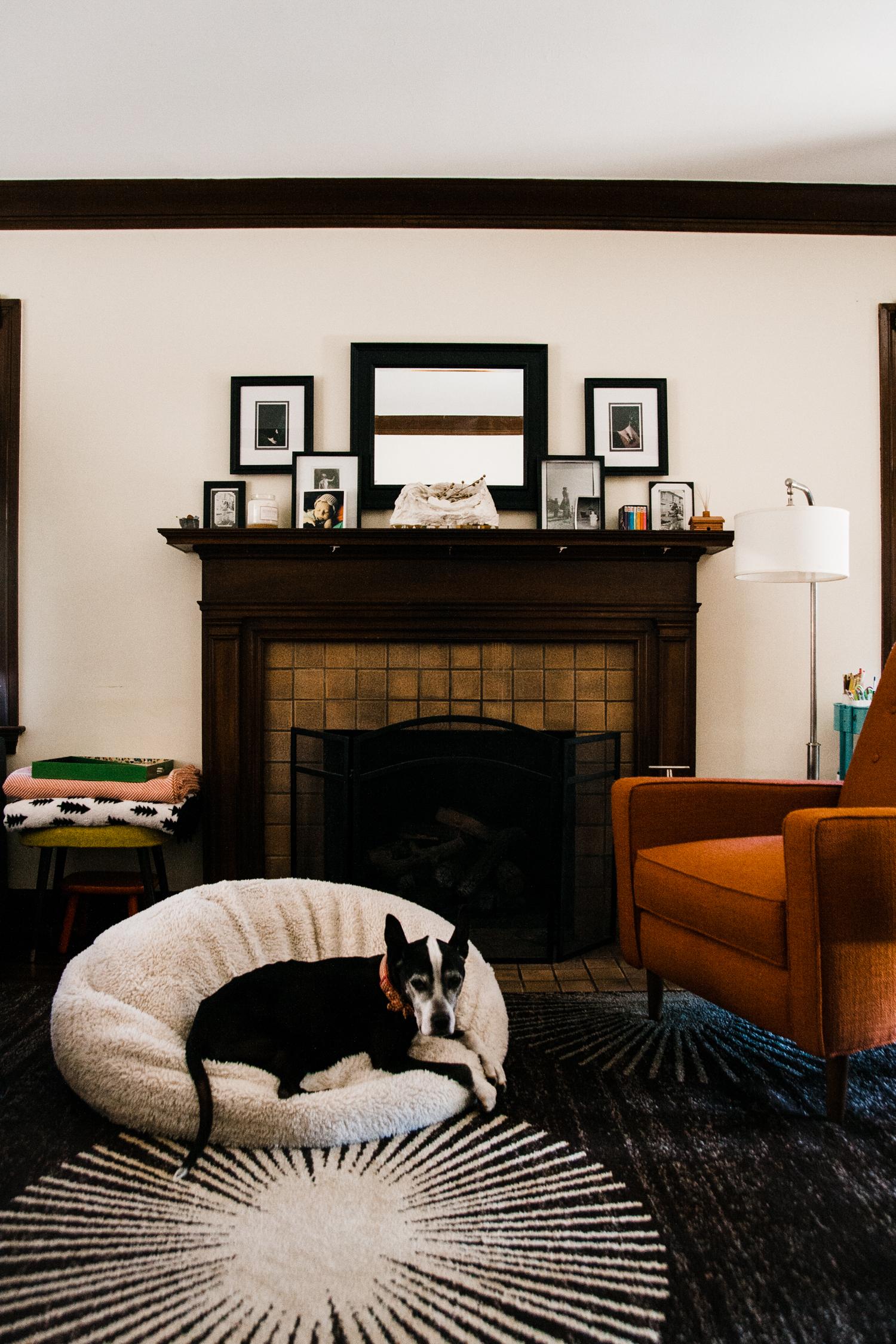 In Allison's modern tudor,    she kept with black frames for her living room, but varied the frames' sizes, widths, and matting.