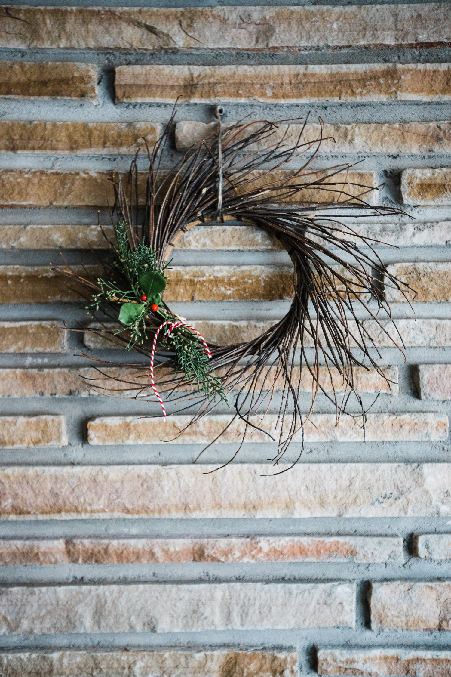 I Christmased up this fall wreath with holly, juniper, and baker's twine. Bada-bing, bada-boom.