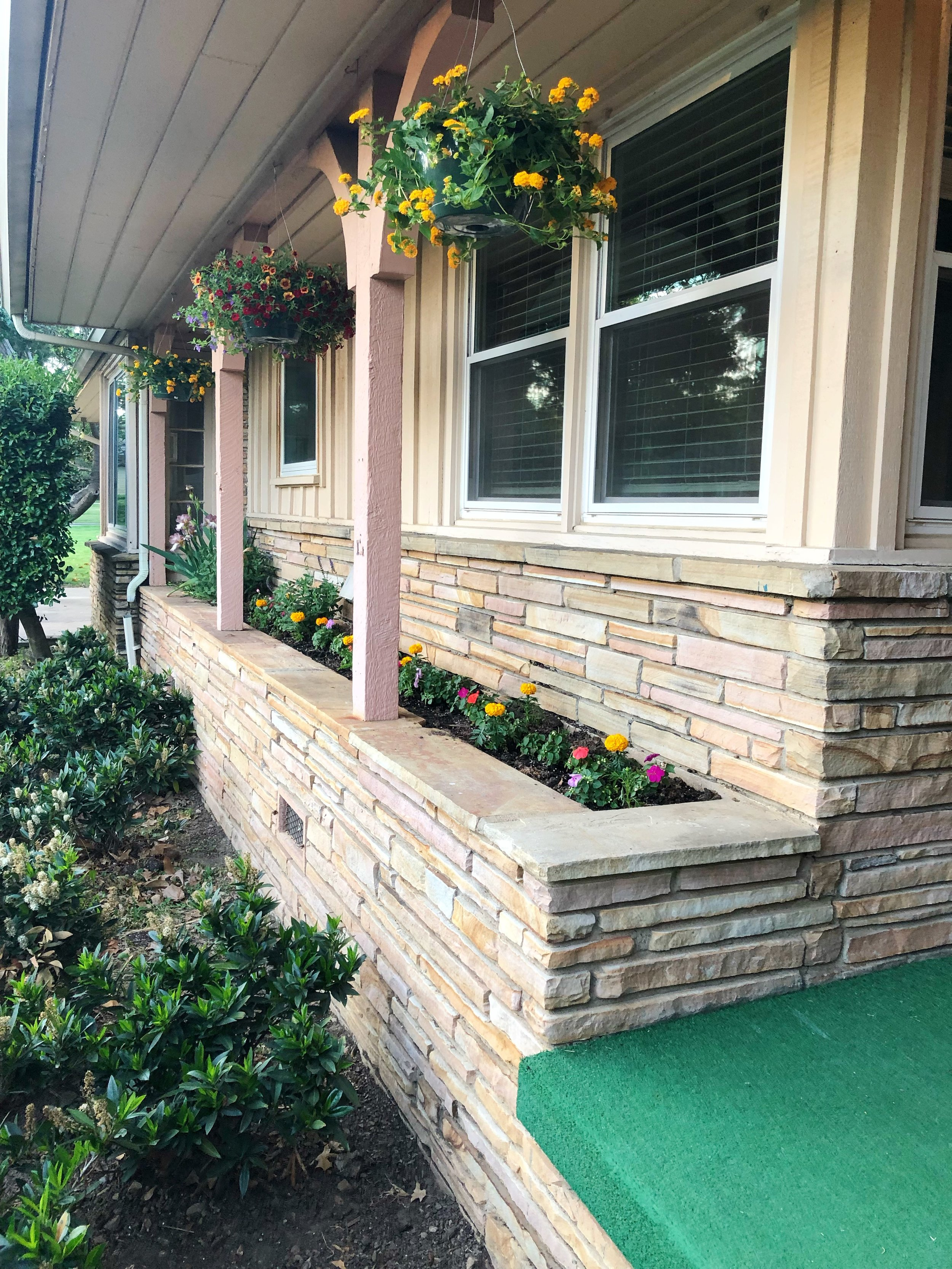 Tulsa midcentury modern home landscaping hanging baskets.jpg