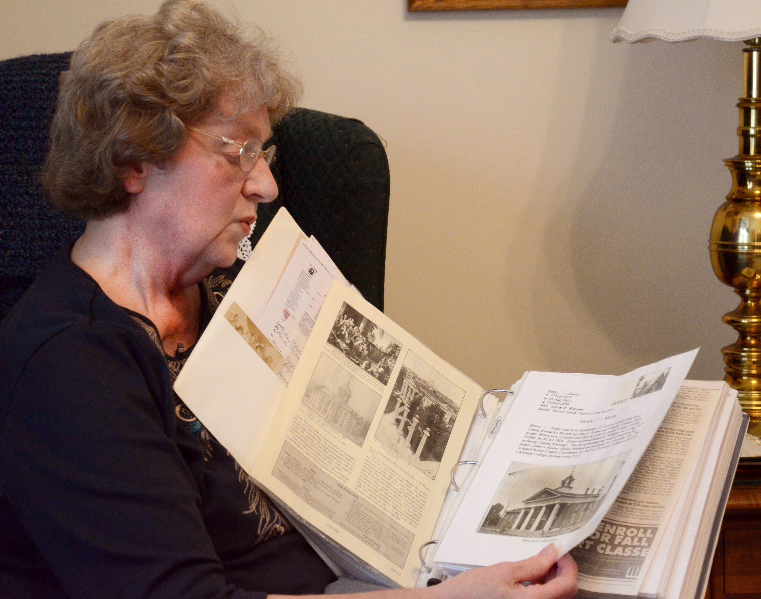Bette Keene Scavone looks through one of the binders she put together that is full of documents on her family history on Wednesday, March 23, 2016, in Columbia, Missouri. She has put together dozens of binders on her family history.