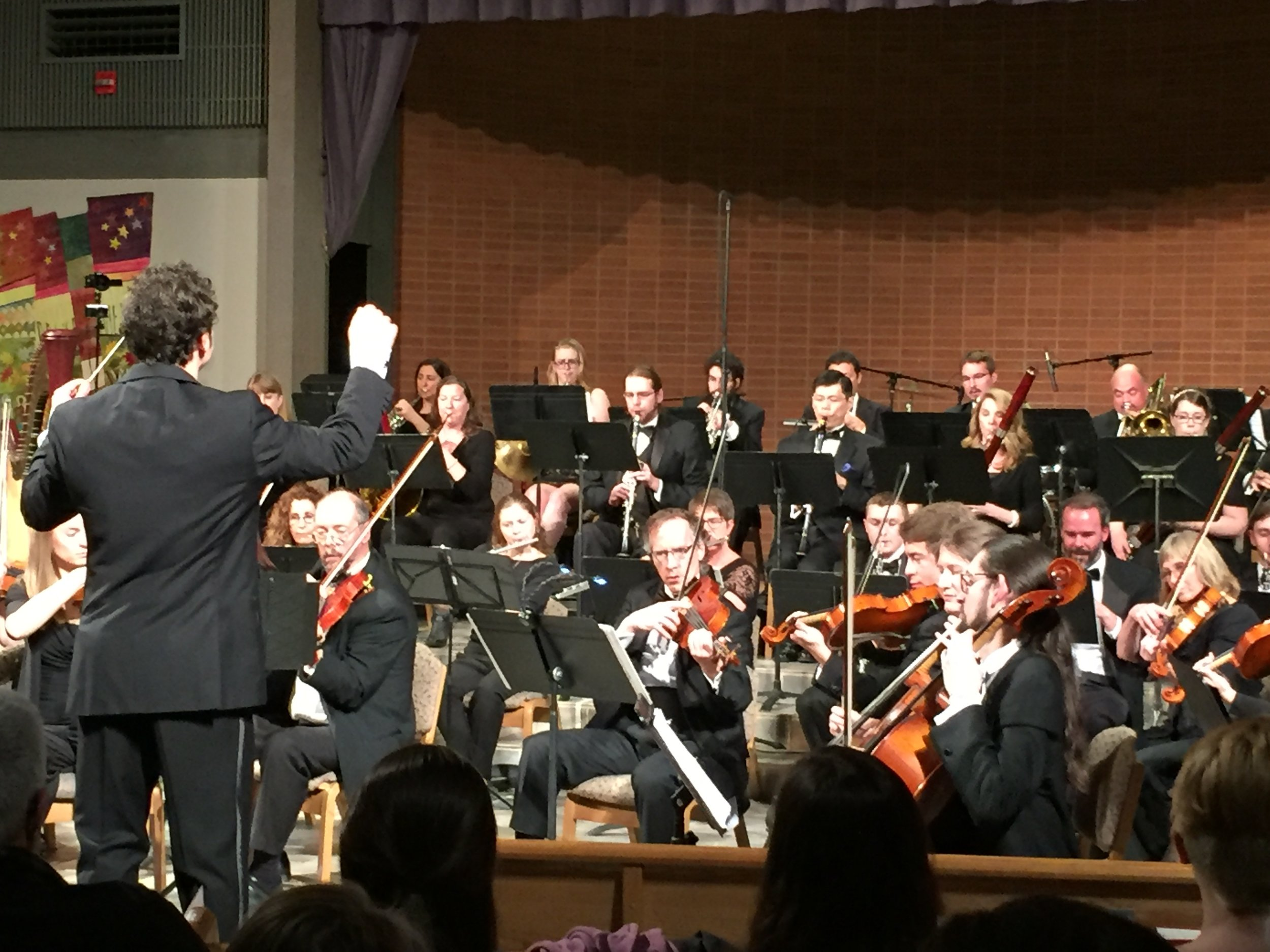 Devin Patrick Hughes Conducting the Boulder Symphony in Downtown Boulder