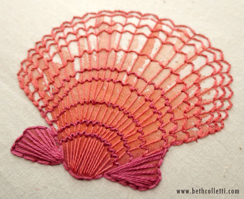 A light wash of watercolor was applied before hand-stitching this seashell.