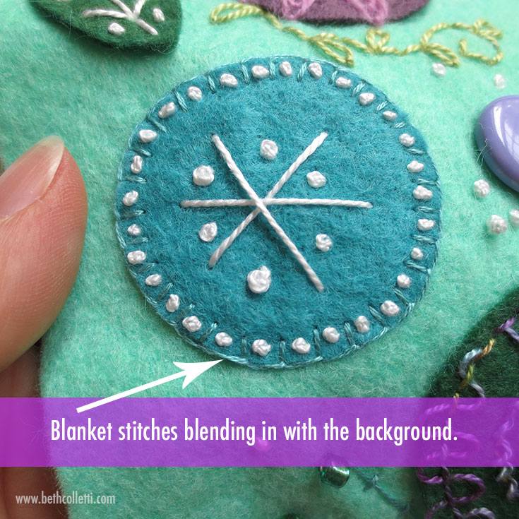 The blanket stitch here blends in with the blue felt.
