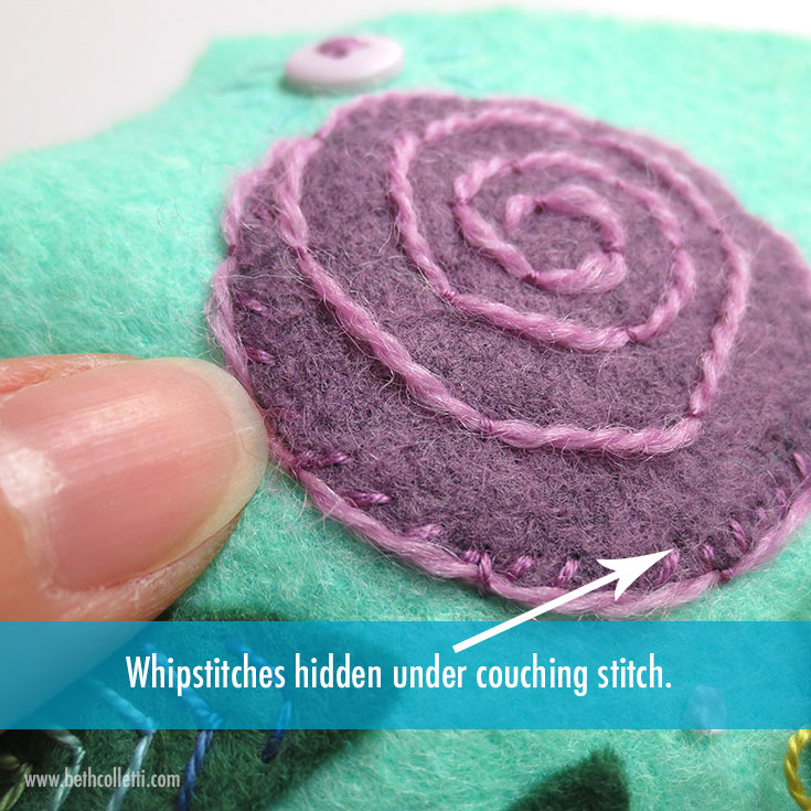The whipstitch here blends in with the purple felt.