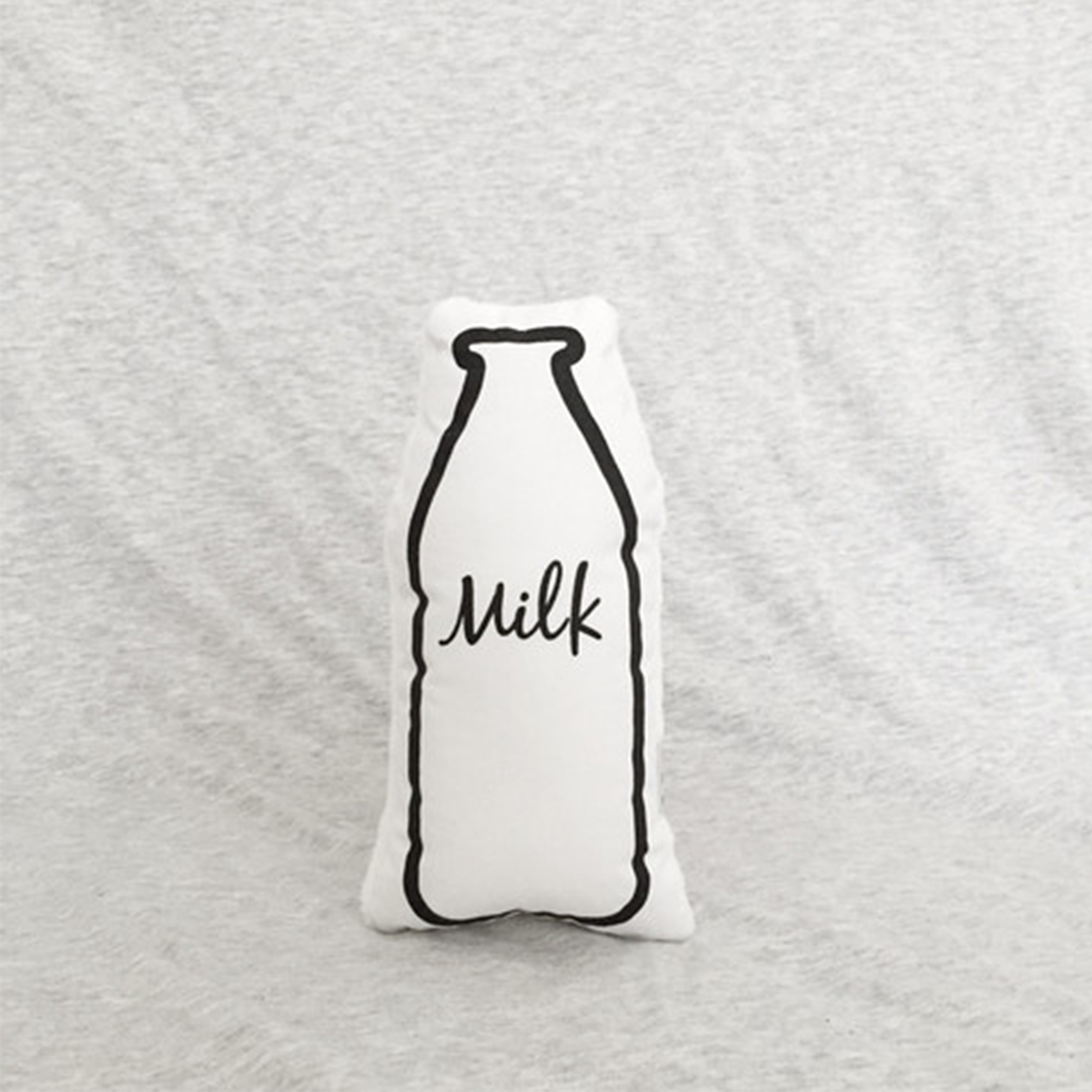 Milk rattle by  The Milk Collective