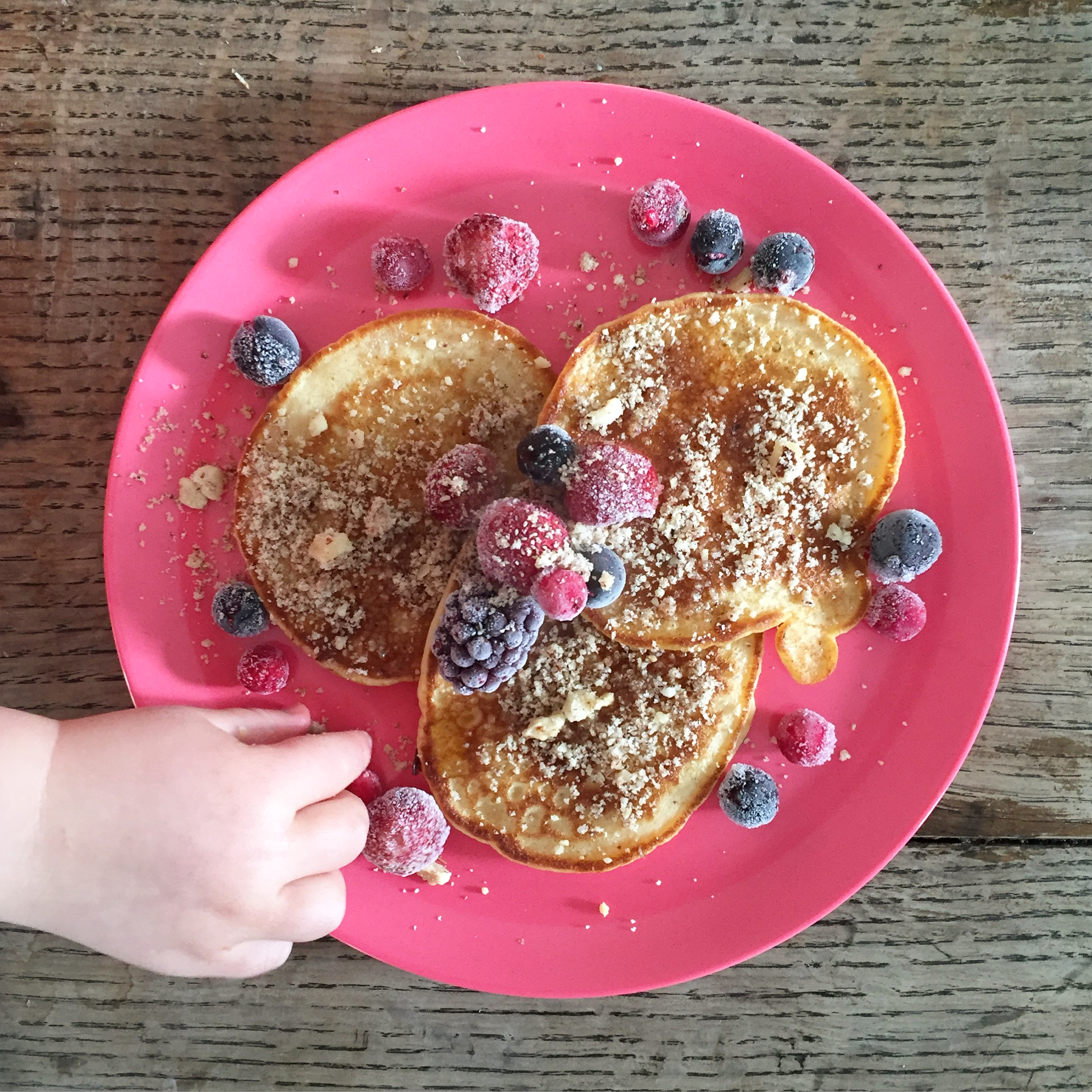 Pancakes..mmmm.  Banana pancakes with frozen berries, hazelnut and pecan dust and a cheeky drizzle of maple syrup