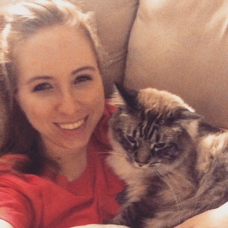 Tiffany: TBT to watching movies on Friday night with this adorable cat.