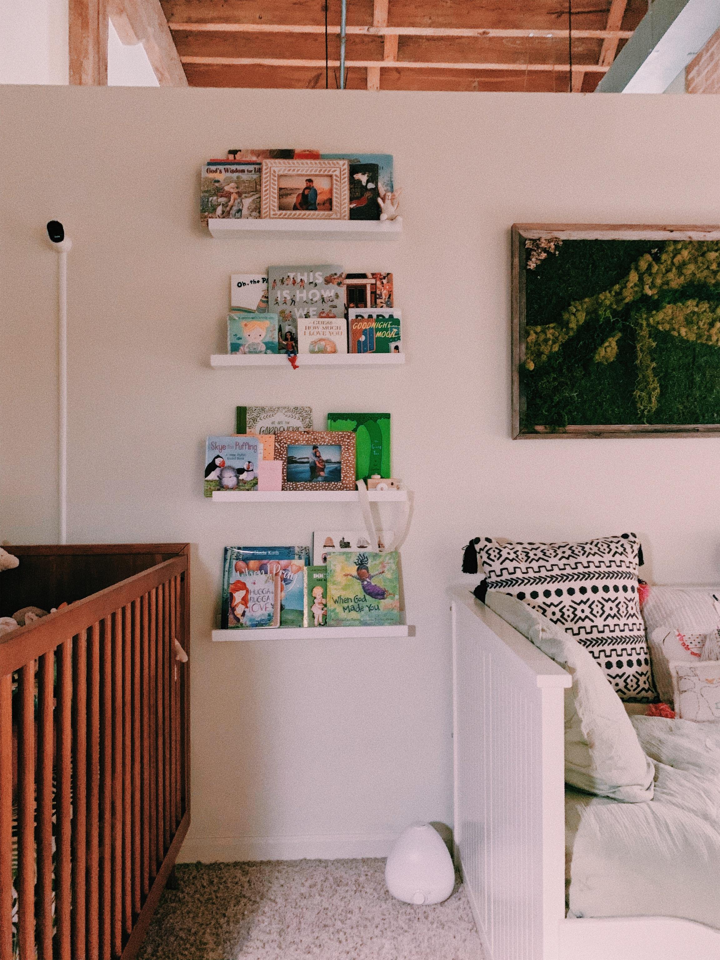 I built her bookshelf with small white frame ledges from Target.