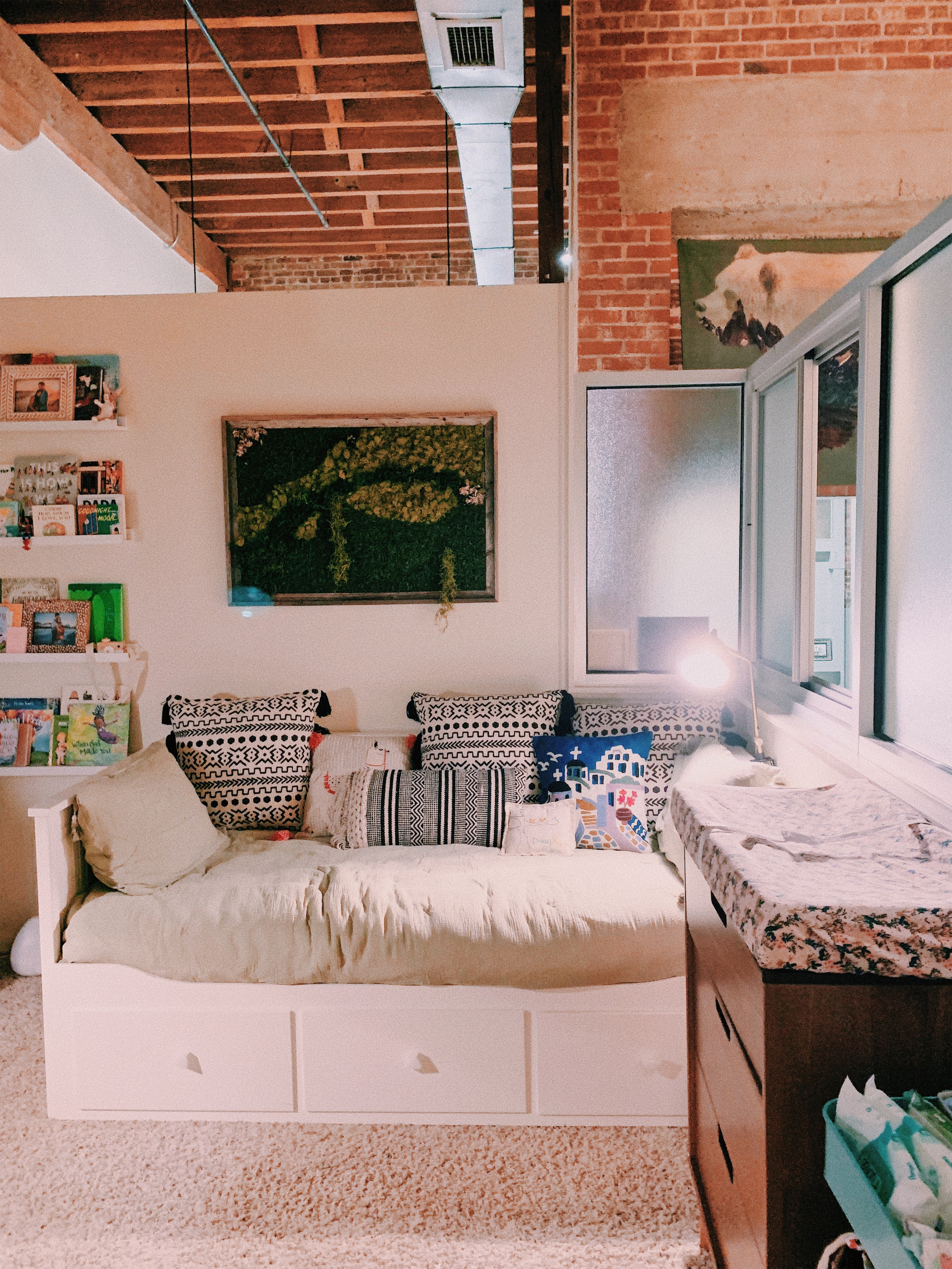 This is a good shot of our open air loft. Her 'room' doesn't have walls that go all the way to the high ceiling.