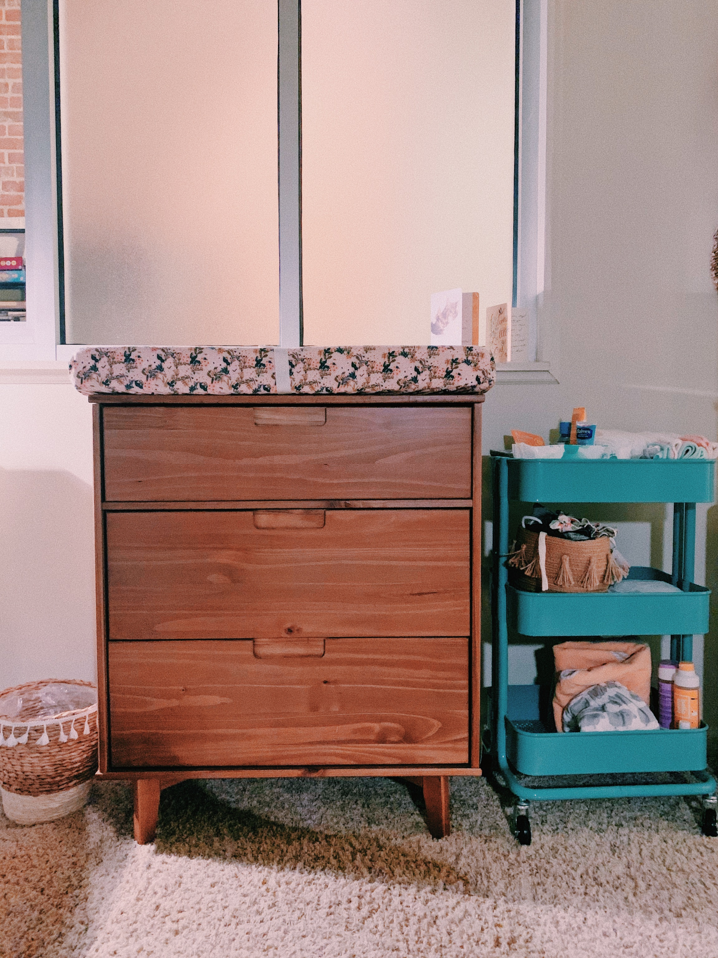 Because her room doubles as a guest room, we needed really small furniture to fit everything. I found this real wood, beautiful mid century dresser on Wayfair.