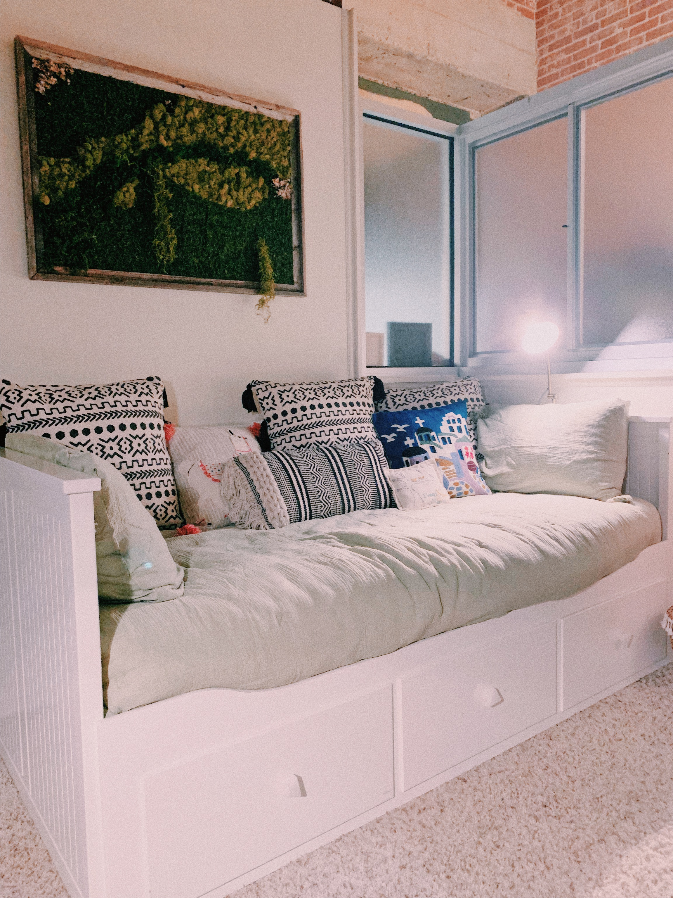 This is our daybed that pulls out into a double for guests. It's an Ikea daybed with World Market knobs.