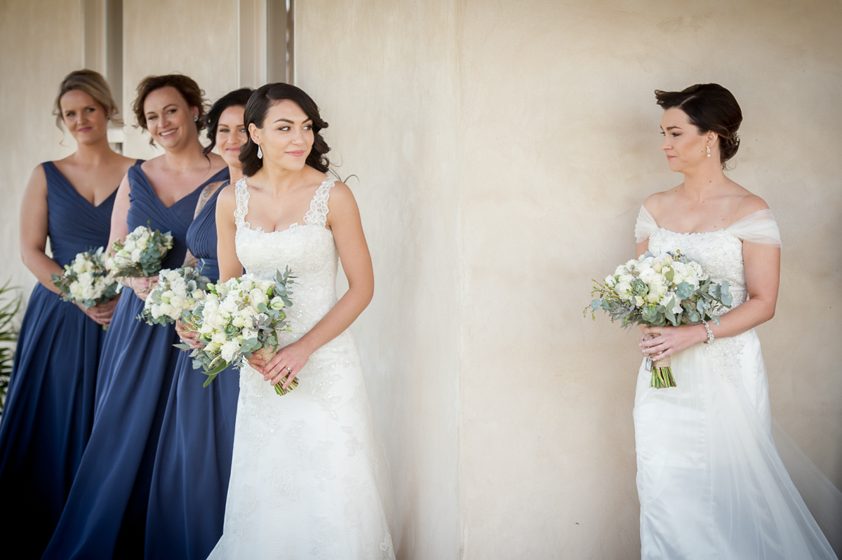 2 brides see each other for the first time on their commitment ceremony day.