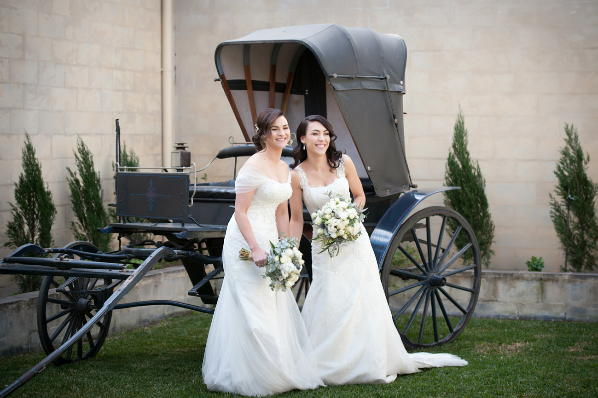 Brides in front of the old cart at Calvin Estate
