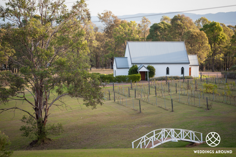 Beautiful white washed Chapel wedding overlooking the vineyard at Lovedale.