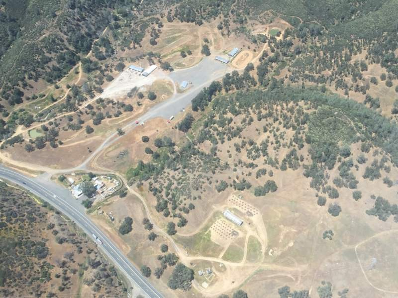 Aerial view shows how illegal pot growers clear areas and cut down trees in mountains of northern California. This view is in Lake County