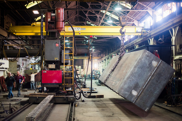 "Steel weighing about 30,000 pounds is lifted by a crane at Columbiana Boiler. ""If something goes wrong, it won't hurt our workers. It'll kill them,"" Mr. Sherwin said. ""And that's why we can't take any risks with drugs."""