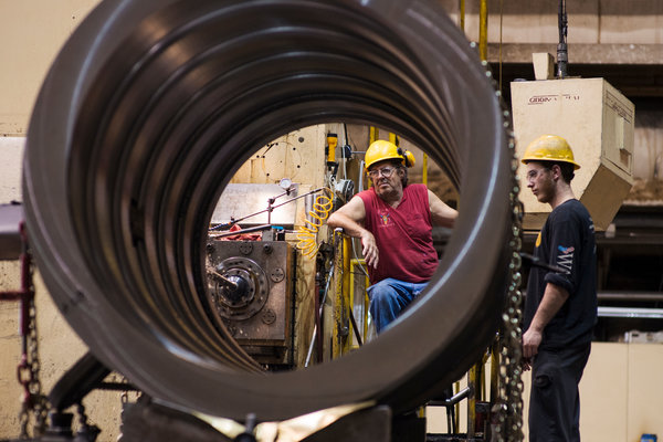 At Warren Fabricating & Machining in Hubbard, Ohio, an apprentice, Andrew DeMattia, right, observed as a machinist, Paul Wysenski, worked on a generator component.