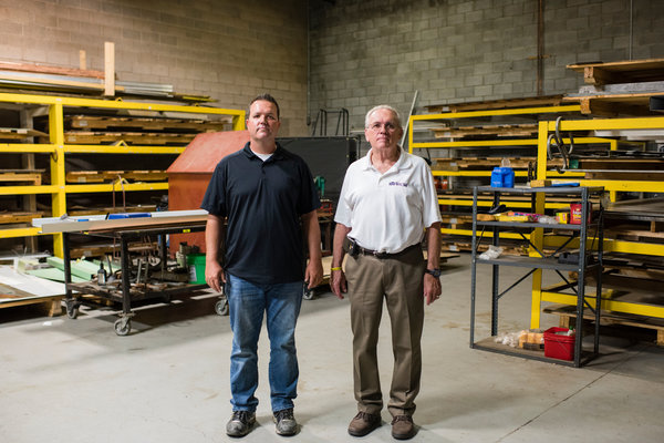 "Chris Cruciger and his father, Bill, in the shop at Roof Rite, a roofing company in Youngstown, Ohio. Chris Cruciger said, ""We could take on twice as many projects if we had more suitable workers."""