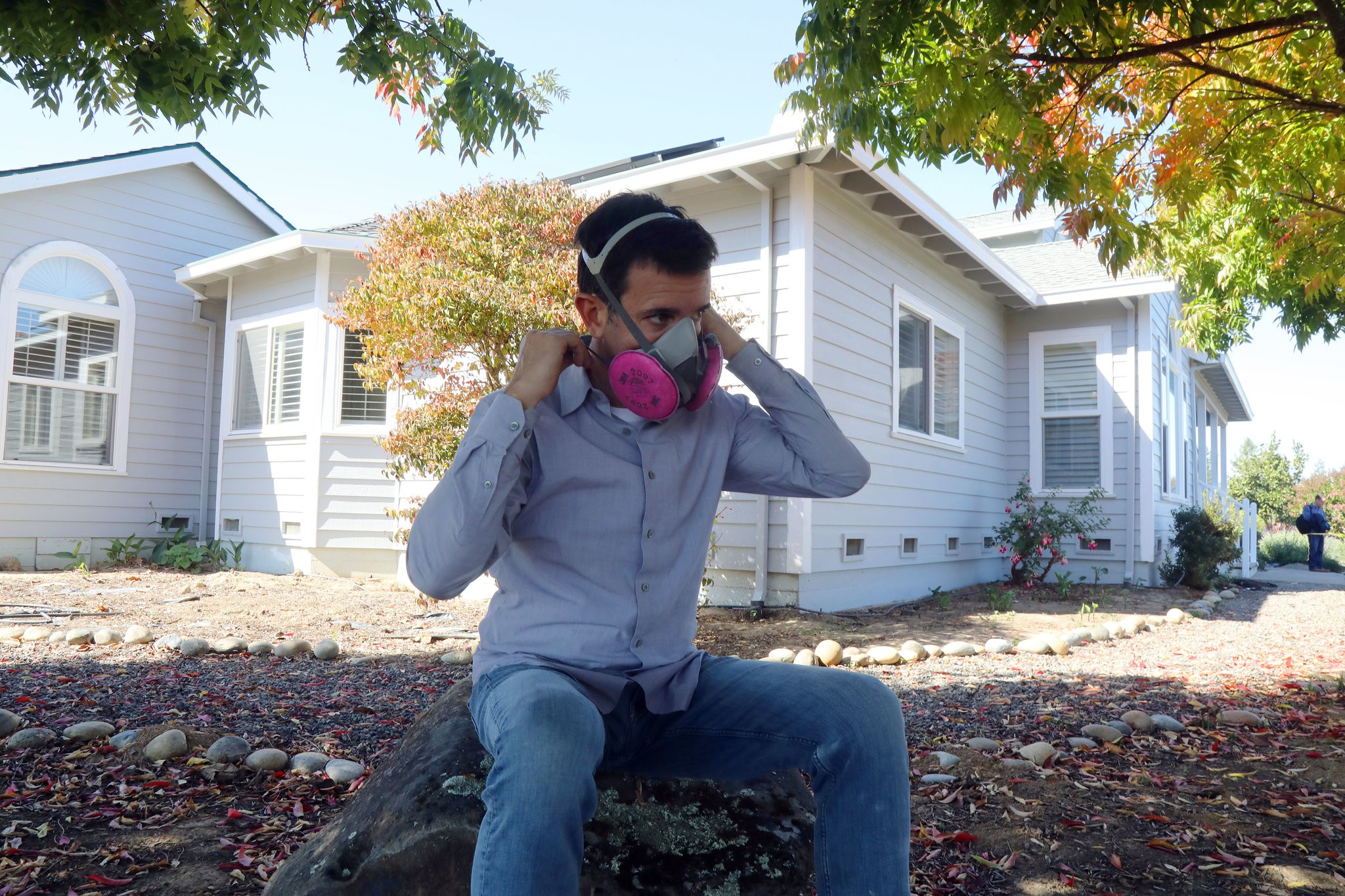 "Robert Guthrie wearing his respirator outside his home in Sebastopol, Calif. ""I can't be outside more than 30 minutes,"" Mr. Guthrie said of peak cannabis odor times .Credit Jim Wilson/The New York Times"