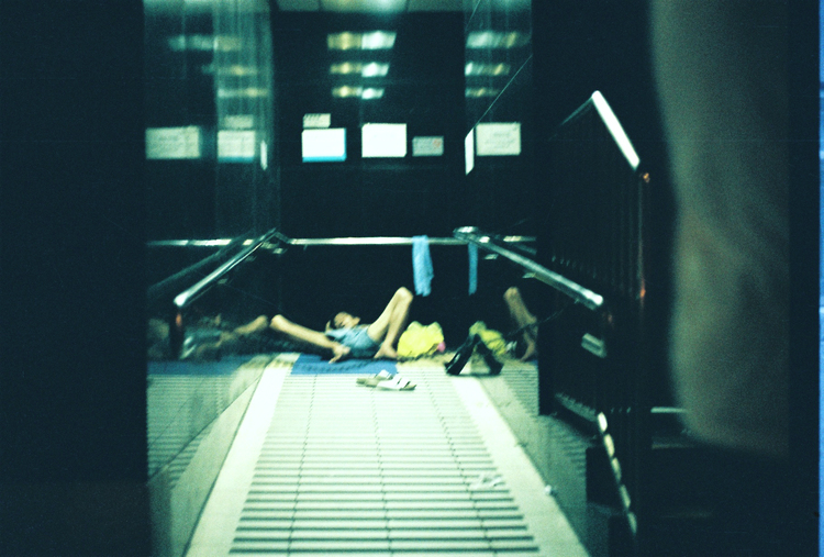 man+lying+down+hong+kong.jpg