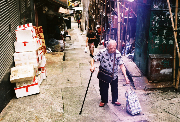 Woman+Walking+Uphill+HK.jpg