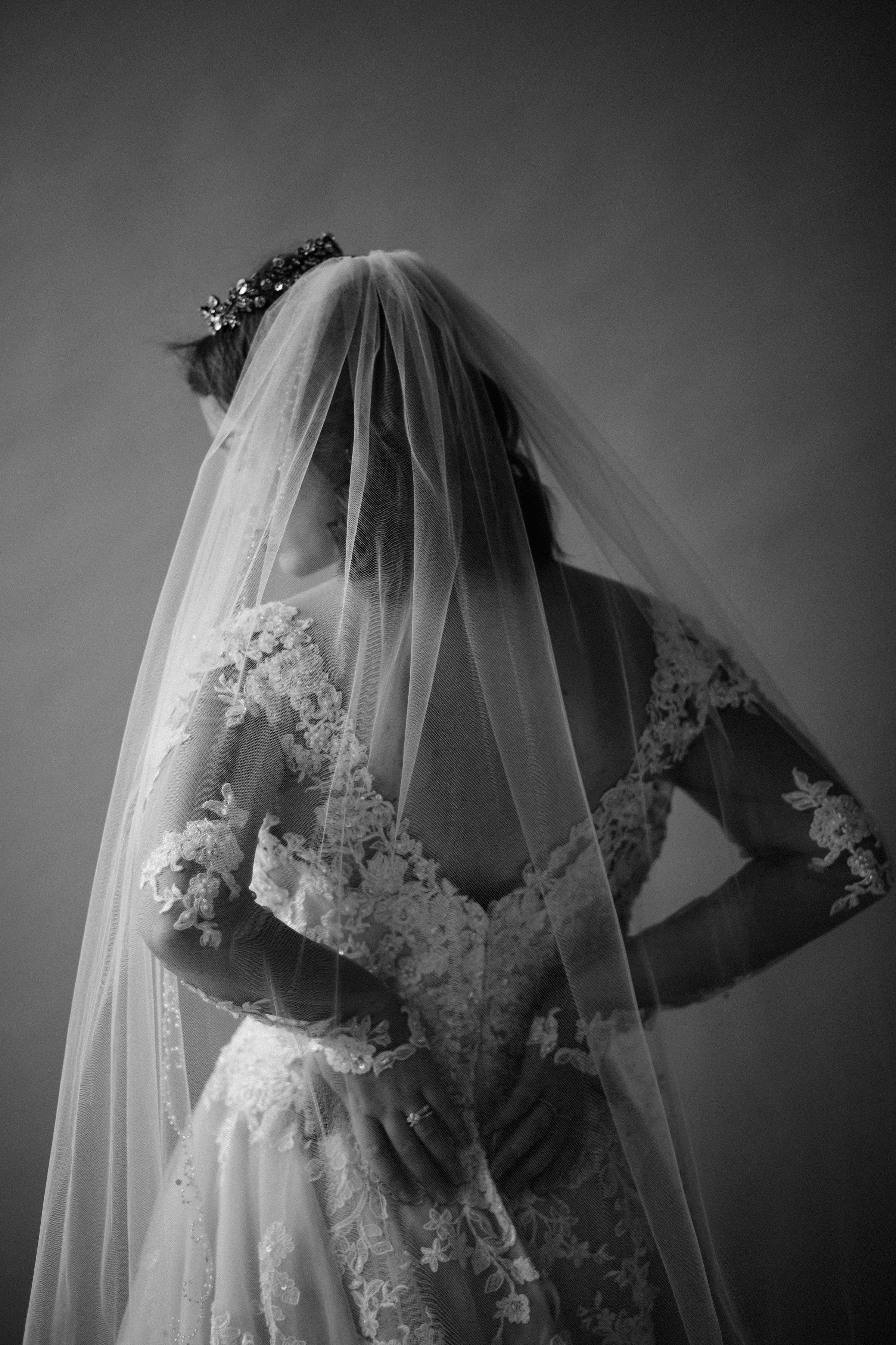 Headpiece: Hair Comes the Bride   Earring: Liz Law   Ring: Icon Stylist   Dress & Veil: Bel Fiore Bridal , Essence of Australia   Hair & Makeup: Corianne Elizabeth Beauty   Photography: Michelle Scott Photography