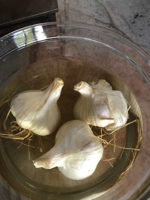 Soak garlic bulbs in white wine, a splash of water and a pinch or more of sea salt