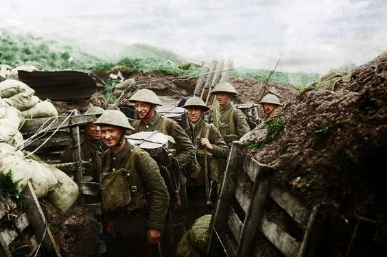 A colorized photo of a British carrying party. The soldier in front has a British Marmite container strapped to his back. (Source: Greatmilitarybattles.com)