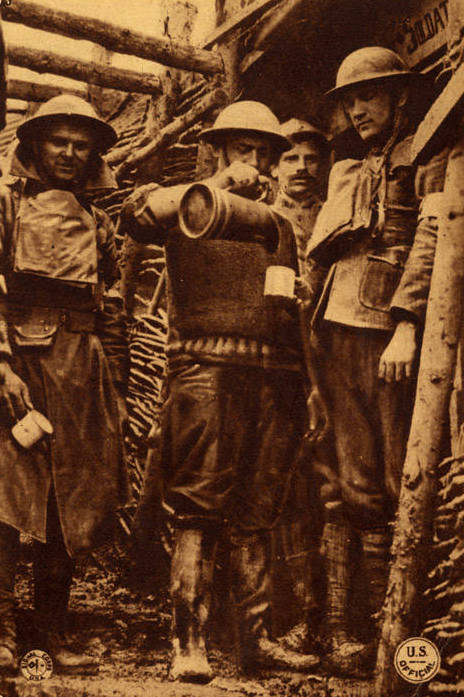 "A ""Y"" Man of the YMCA pours coffee for American troops on the line as a French Poilu looks on"