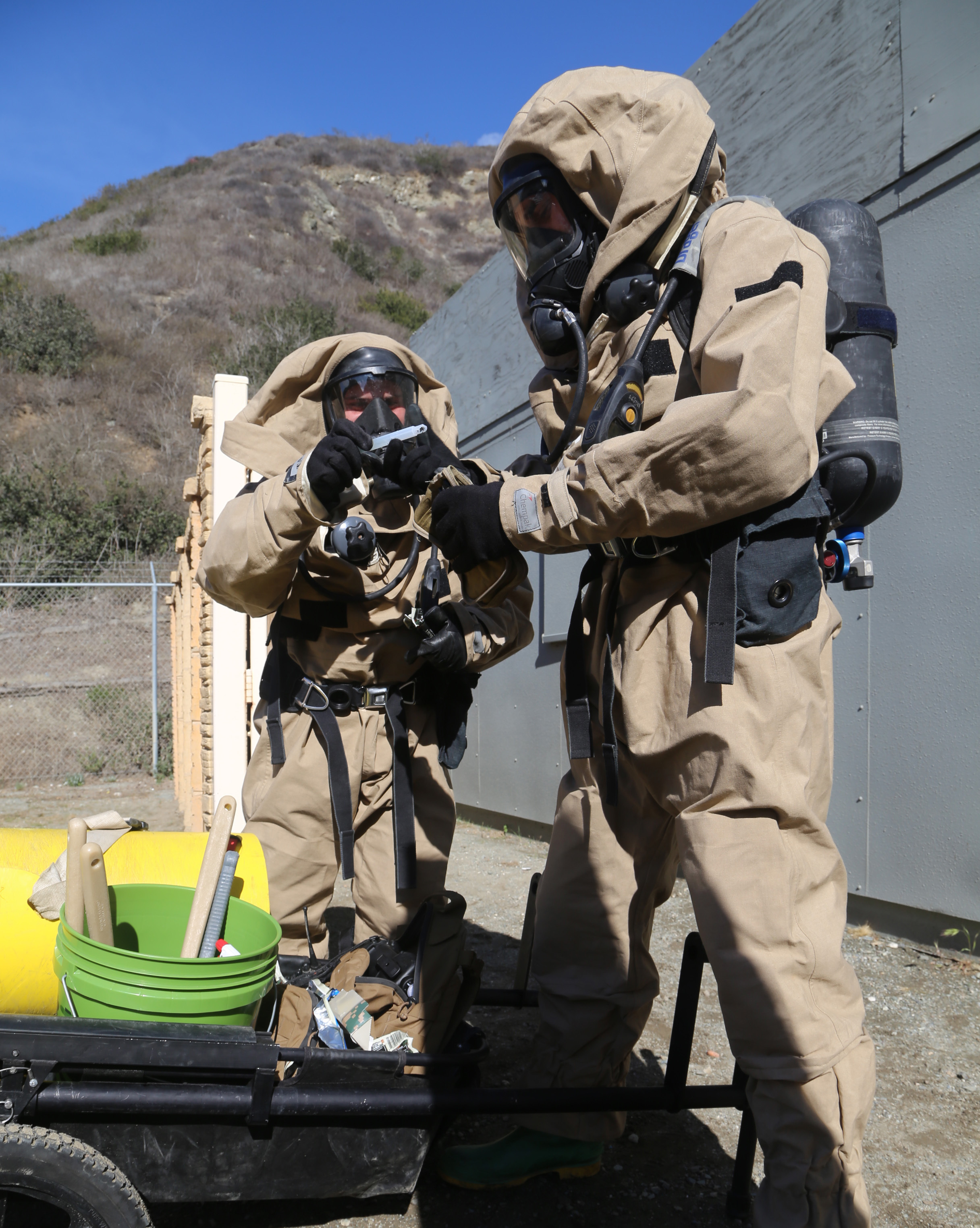 Camp Pendleton, California (7 February 2014) - SGT Jeffrey Fahrenbach and LCPL Matthew Streitenberger, CBRN Specialists with the 11th MEU, conduct CBRN Sensitive Site Exploitation training. (Source: DVIDSHub.net, US Marine Corps Photo by CPL Demetrius Morgan)