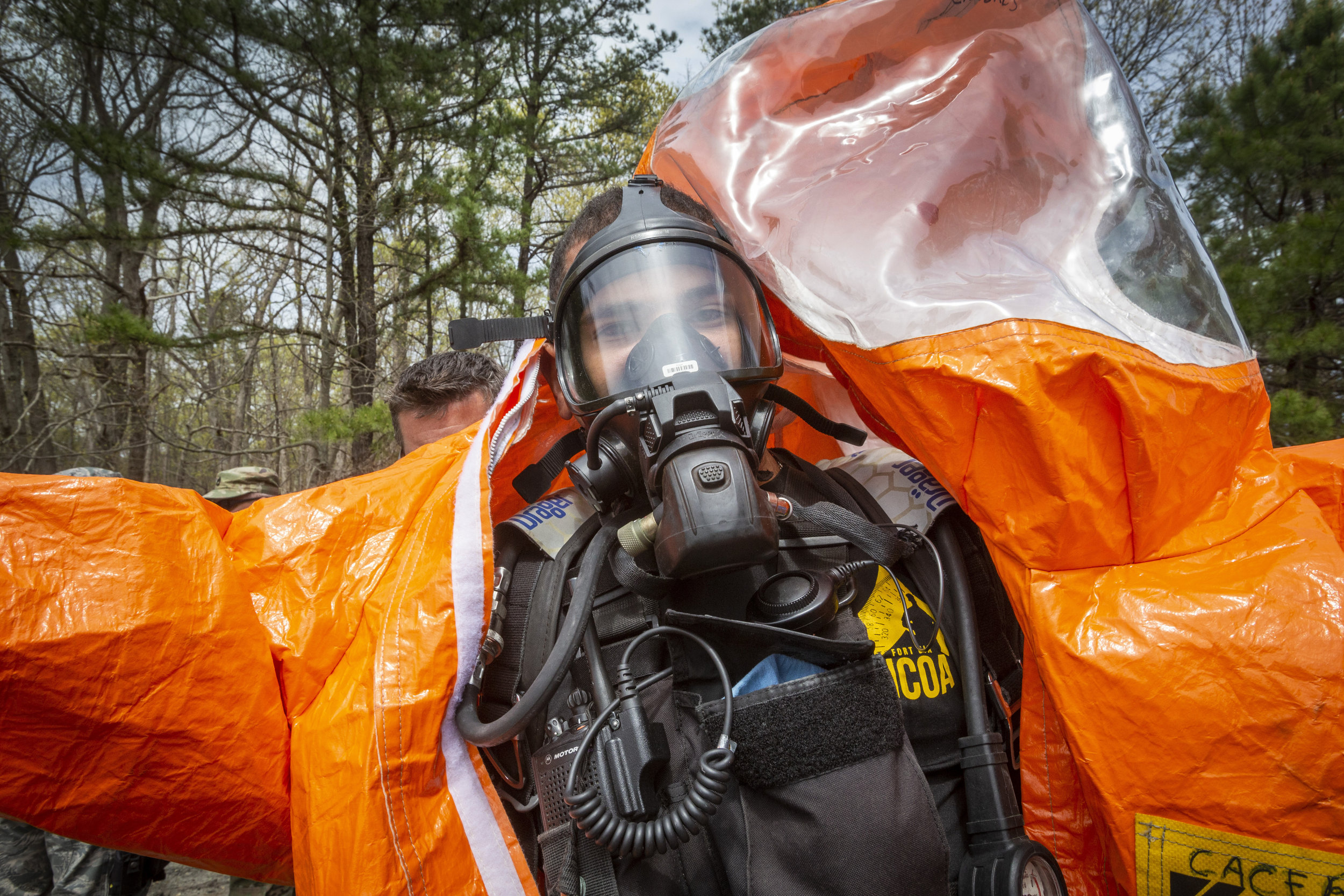 Colts Neck, New Jersey (25 April 2019) - 21st CST-WMD (New Jersey) survey team member SGT Mauricio Caceres dons his Level A suit during an Army North recertification evaluation. (Source: DVIDSHub.net, Mark Olsen, New Jersey National Guard).