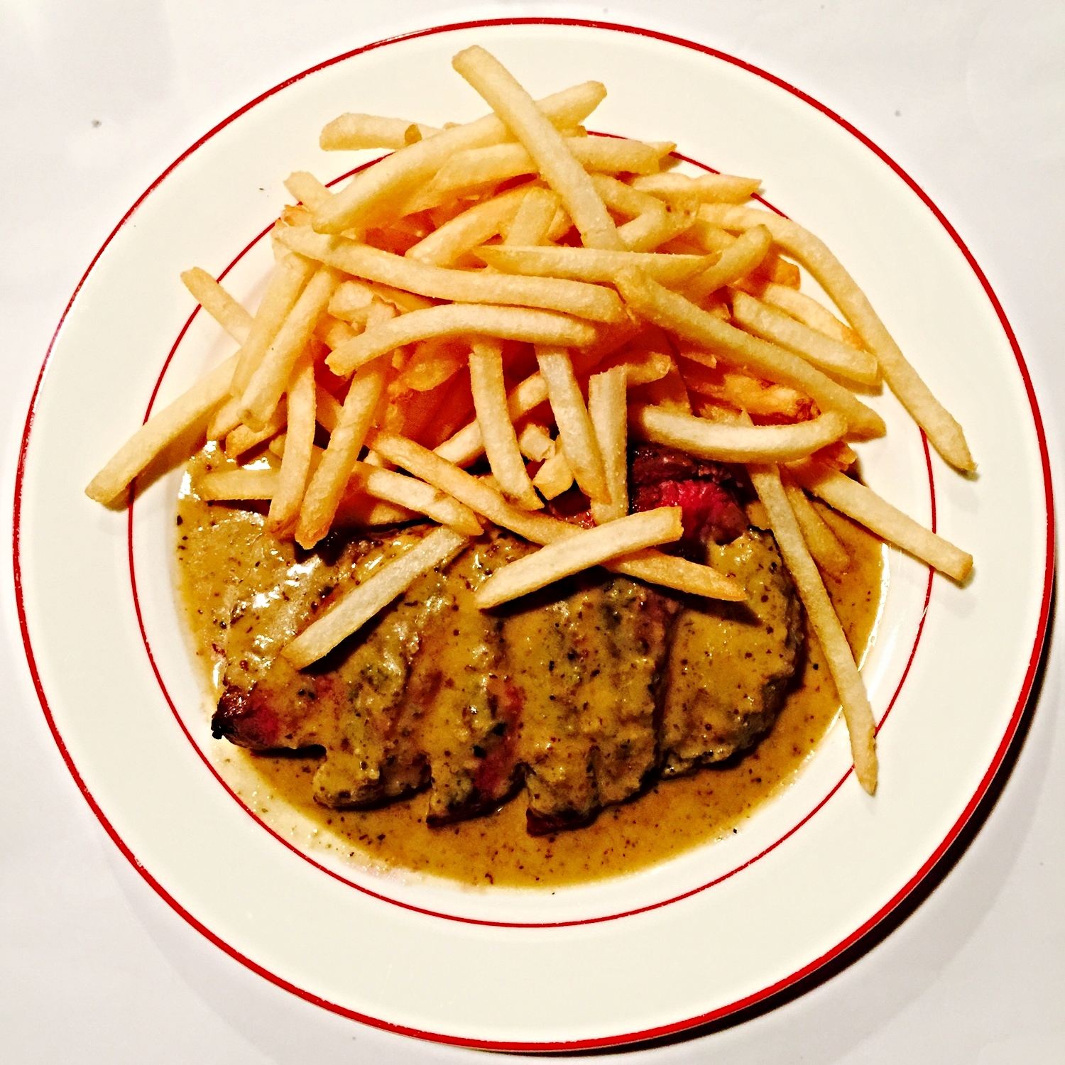 The 'classic' Entrecôte Steak & Fries - 200 grams of  Entrecôte Steak with its 'legendary' (butter-based) sauce and Unlimited Golden French Fries