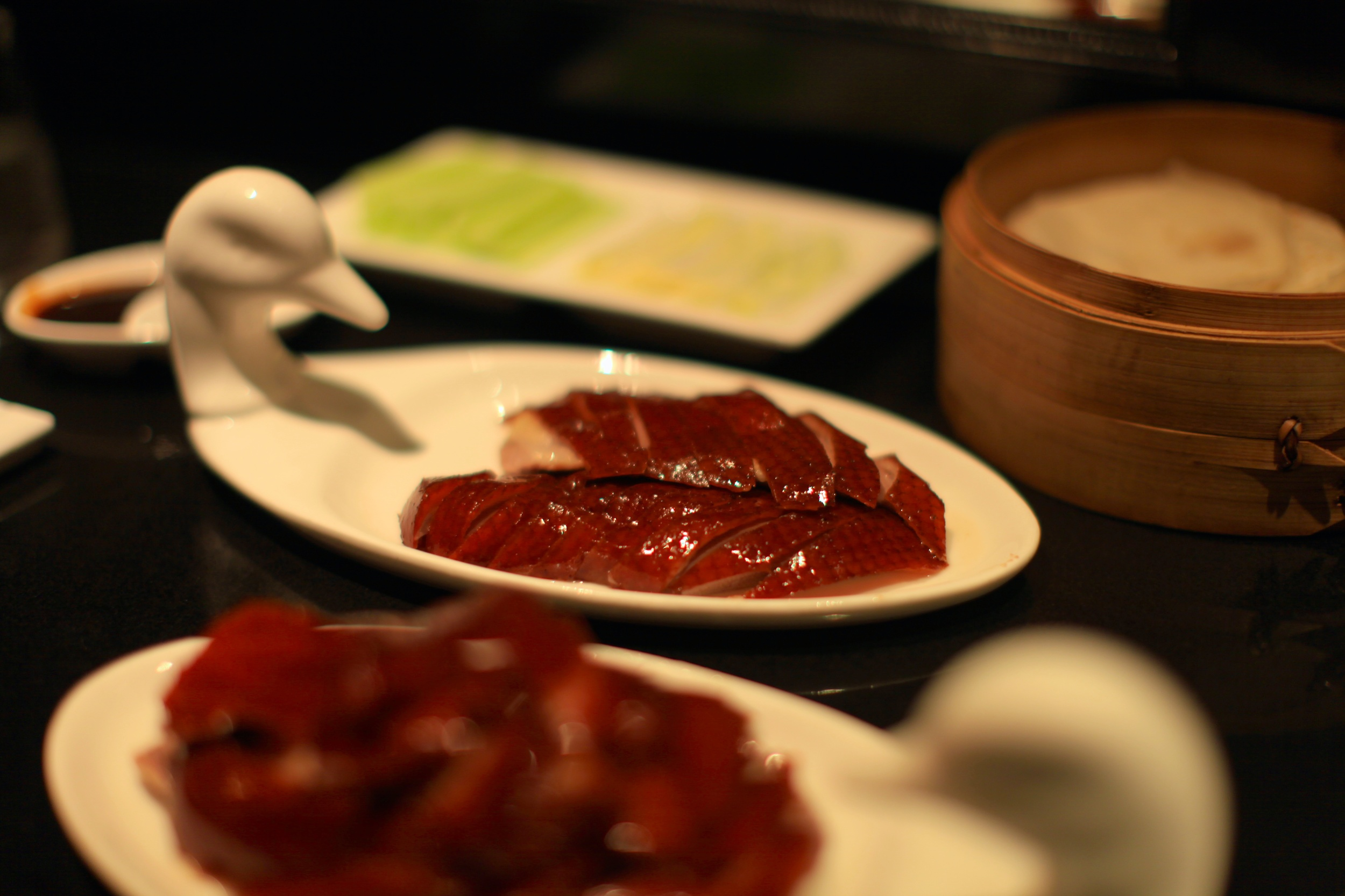 The meat is then carved and served in two plates,
