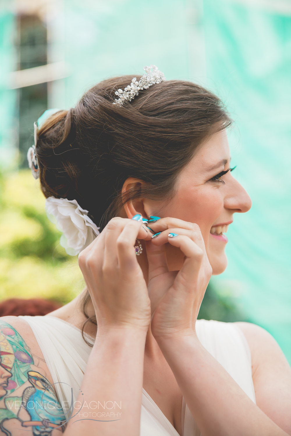 Pastel Turquoise and ivory just gets the bride's amazing tattoo stand out so beautifully!