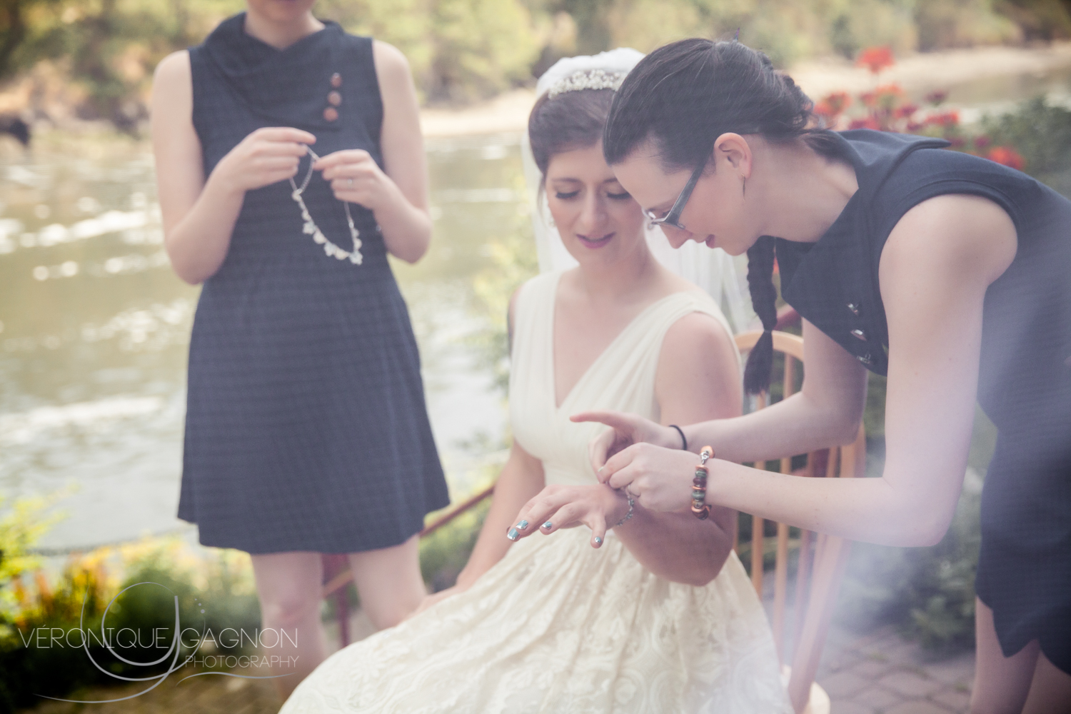 Bridesmaids helping the bride getting ready along the  Gorge Waterway .