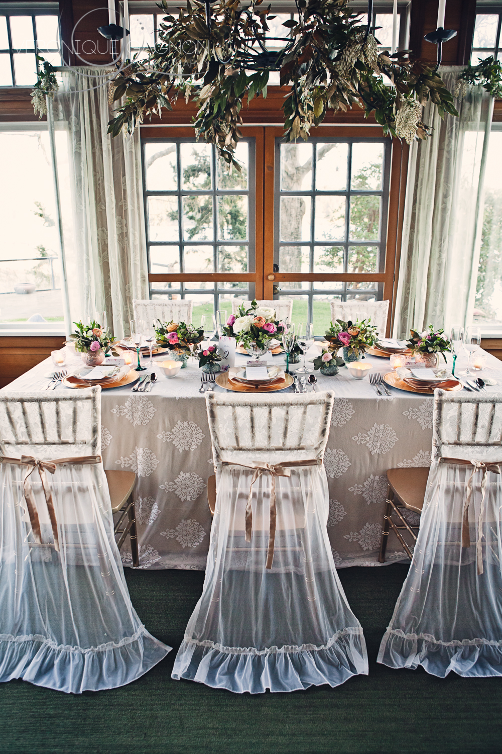 Sheer white chair cover for a romantic look.