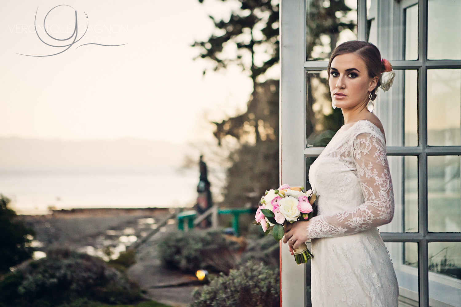 Marjorie wearing a beautiful lace wedding gown from  Blush Bridal boutique  in Victoria and stunning Leah Alexandra earrings from  Violette boutique .