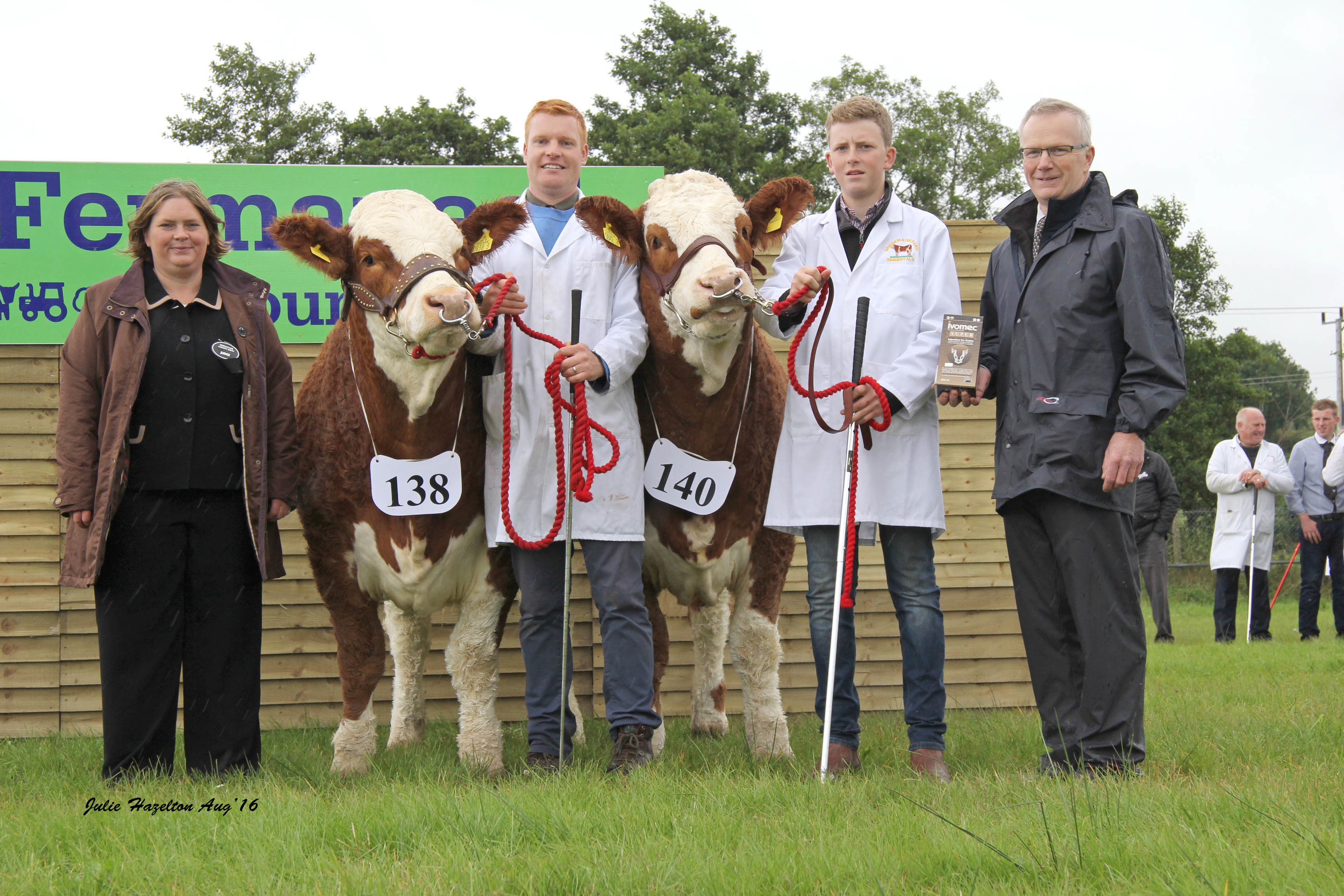 The 2016 Ivomec Super Simmental Pair of the Year winners were Lisglass Fabulous and Lisglass Felicity bred by Leslie and Christopher Weatherup, Balllyclare. Pictured at the presentation are judge Bridget Borlase, Hertfordshire; handlers Christopher Weatherup and Conor Loane; and sponsor Philip Clarke, Merial Animal Health.