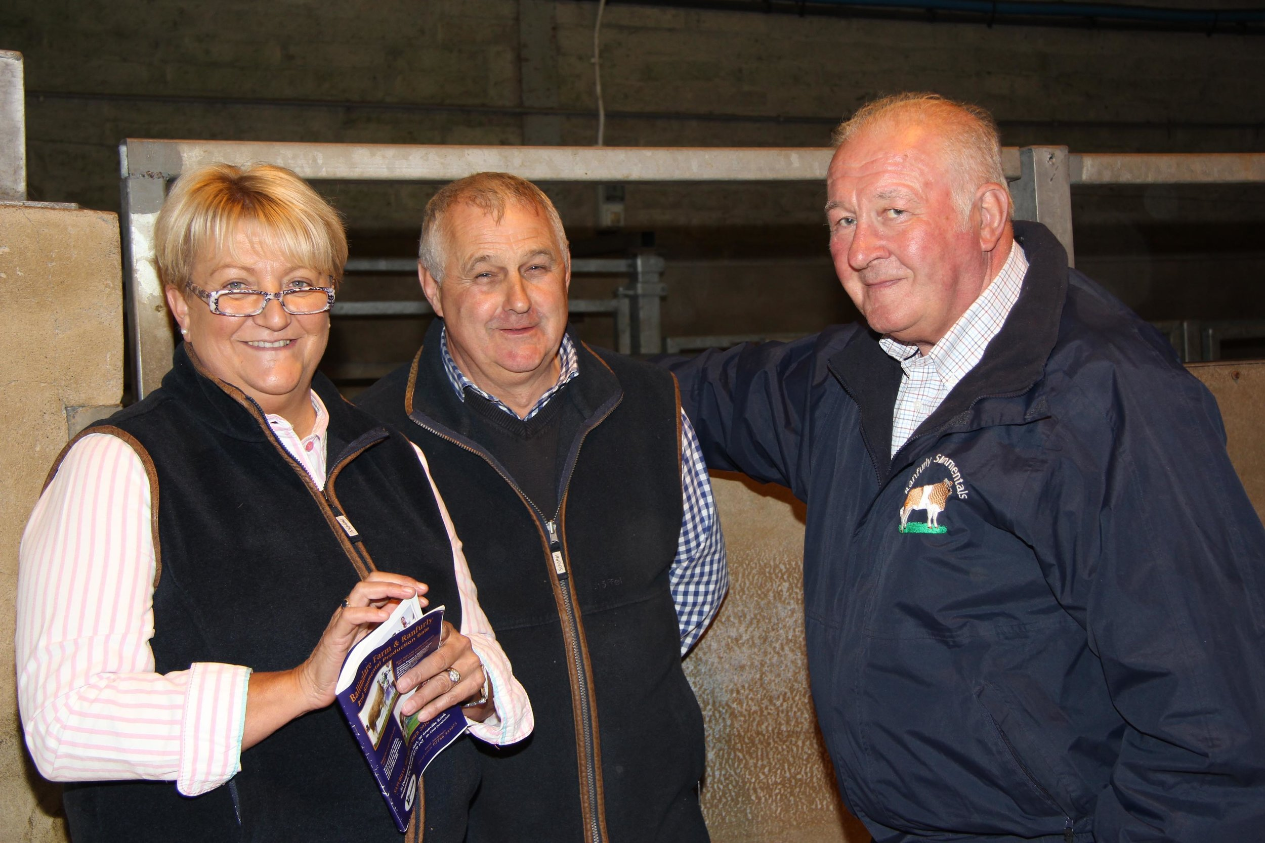 David Hazelton, right, Dungannon, chats to English Simmental breeders Jimmy and Vikki Wood