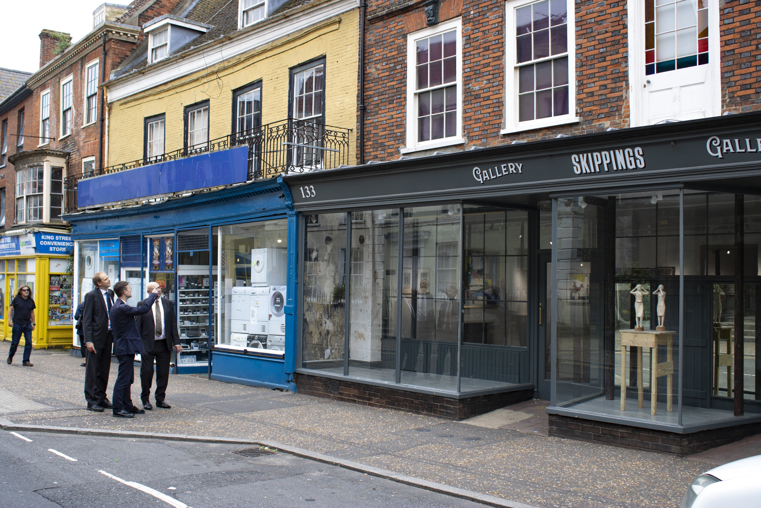 Carl Smith, David Glason and Matthew Mckeague outside the recently reopened Skippings Gallery, with housing uses above, all of which are now owned and operated by Great Yarmouth PT