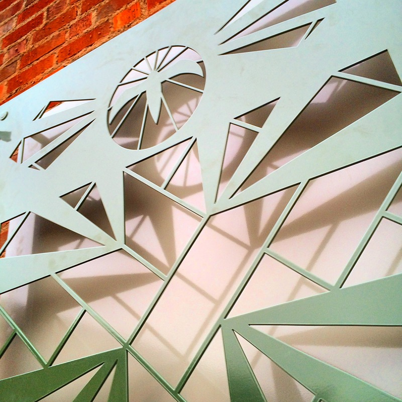 Design watercut through aluminium sheet and powdercoated - Vilunda church. upplands väsby, Sweden