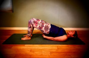 Working Bridge - Place your feet on the mat with knees in the air. Your feet can be arms length or further away. Gently push into your heels and raise your lower back off the mat. Clasp your hands together underneath you if you desire.