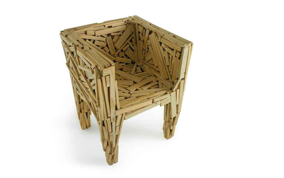 17/20 The Favela armchair is now made in Italy, each piece of timber placed and fixed by hand to an internal steel frame.